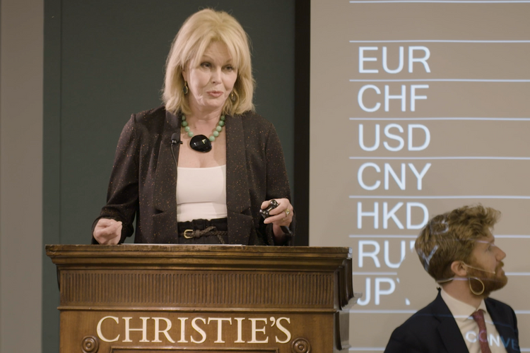 Abso-lot-ely fabulous: Joanna Lumley tries out her auctioneering skills at Christie's