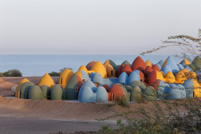 Clusters of Candy-Colored Domes Designed for Communal Living Populate Iran's Hormuz Island