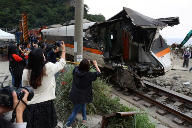 Workers clear last train from deadly crash site in Taiwan