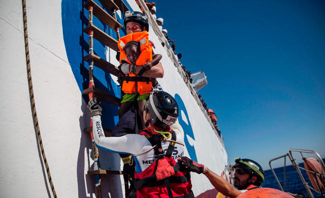 Italy says Libyan coast guard fired on its fishing boats, injuring captain
